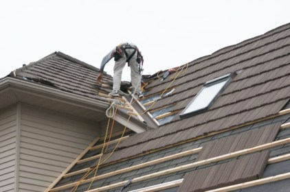 Here is one of our incredible installation professionals carefully installing a steel shake roof. Notice that Metal Roof Outlet's incredible products can easily be installed over existing rooofing for a low-maintenance renovation or build solution.