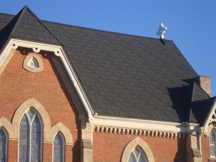 Metal Roof Outlet is not limited to residential projects - this steeply sloped church roof is now decked out in Steel Shake in the colour Weathered Slate.