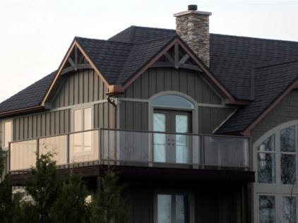 This cottage-style two-story home in Ontario features a bold Onyx Steel Shingle from Metal Roof Outlet