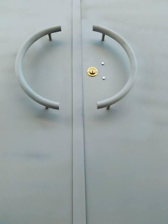 portão em chapa de duas folhas