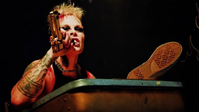 "Otep - OTEP Slams President Supporters: ""He's A Racist, Rapist Sack Of Sewage"""