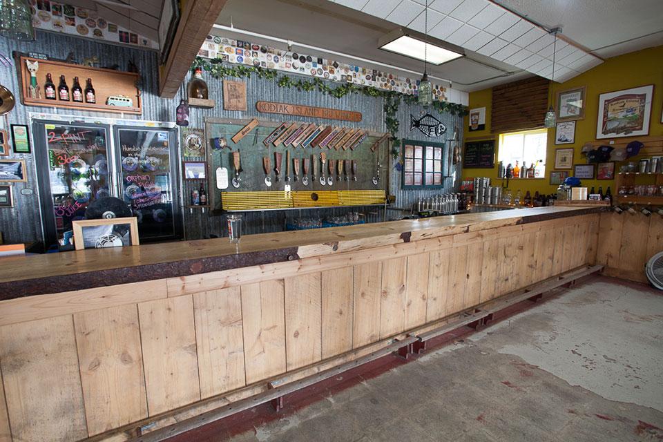 Spruce slab bar top, salvaged wood footrail