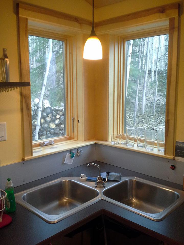 Corner sink and corner window with birch trim
