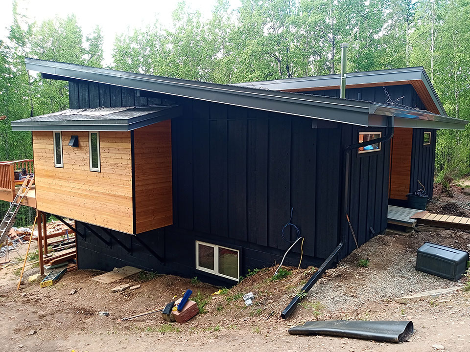 Black stained board and board siding with fine-line cedar accent siding