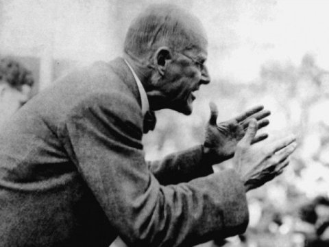 "Eugene Debs delivering a speech in Chicago in 1912. ""I can see the dawn of the better day for humanity,"" the famous socialist leader once said. ""The people are awakening. In due time they will and must come to their own."" (Photo: Wikipedia)"