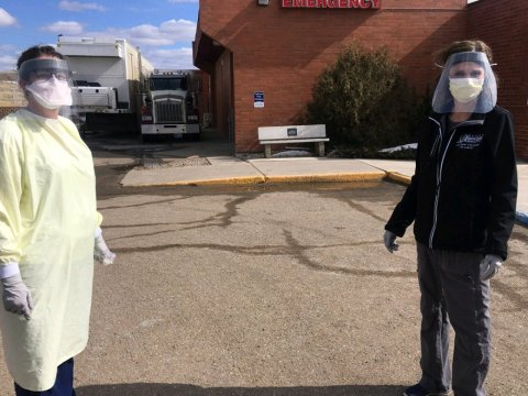 Crystal Rattler, a registered nurse, and Jody Heryford, a technologist, collect patient specimens curbside at Marias Medical Center during a surge of COVID-19 cases in Toole County, Montana. (Courtesy of Marias Medical Center)