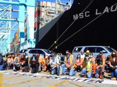 Workers at APM Terminals on Pier 400 in the Port of Los Angeles were among International Longshore and Warehouse members paying tribute to George Floyd Tuesday, June 9, on the day he was laid to rest. (Photo: Robin Doyno via ILWU)
