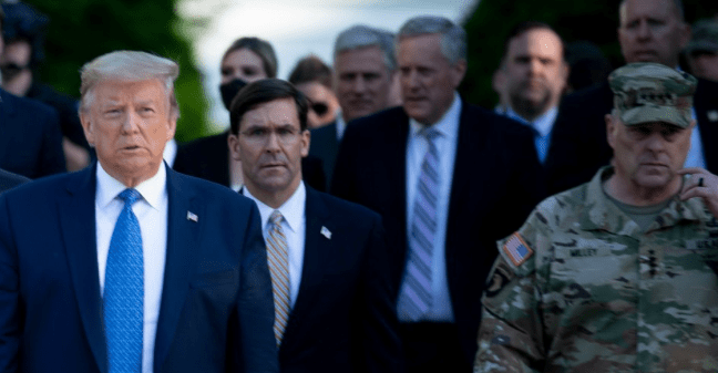 President Donald Trump walks with Attorney General William Barr, Secretary of Defense Mark Esper, Chairman of the Joint Chiefs of Staff Mark Milley, and others from the White House to visit St. John's Church on June 1, 2020, in Washington, D.C. (Photo: Brendan Smialowski/AFP via Getty Images)