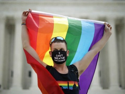 Joseph Fons holds a Pride Flag in front of the U.S. Supreme Court building after the court ruled that LGBTQ people can not be disciplined or fired based on their sexual orientation on June 15, 2020 in Washington, D.C. (Photo: Chip Somodevilla)