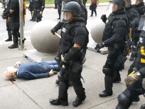 Police officers in Buffalo, New York walk by the motionless body of 75-year-old Martin Gugino as he bleeds from his ear after being attack attacked by officers during a protest on June 5, 2020. (Photo: Screengrab/WBFO)