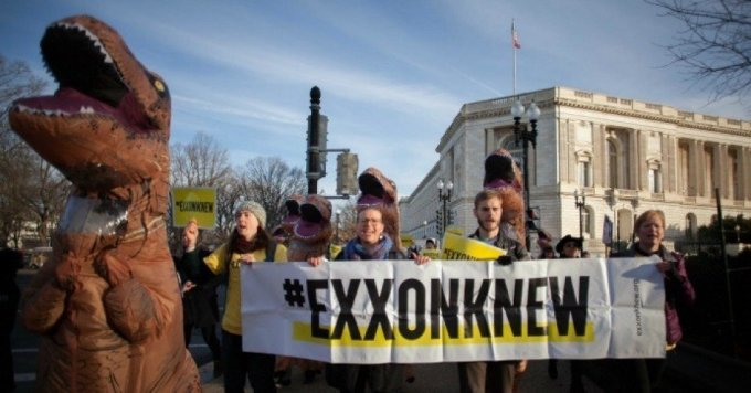 Joined by 15 T-Rex dinosaurs, more than 200 people demonstrated in January of 2017 against the appointment of former ExxonMobil CEO Rex Tillerson for secretary of state, urging senators to #RejectRex. (Photo: Eman Mohammed/350.org)