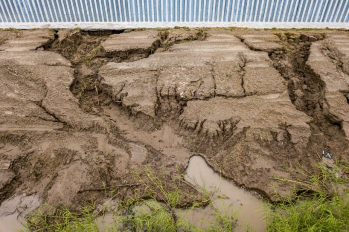 Rain from Hurricane Hanna left a large trail of soil erosion beneath and around the privately funded border wall in South Texas. (James Hord for The Texas Tribune/ProPublica)