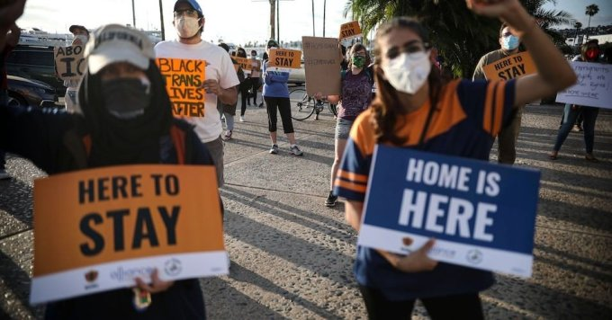 People hold signs during a rally in support of the Supreme Court's ruling in favor of the Deferred Action for Childhood Arrivals (DACA) program, in San Diego, California on June 18, 2020. (Photo: Sandy Huffaker/AFP)