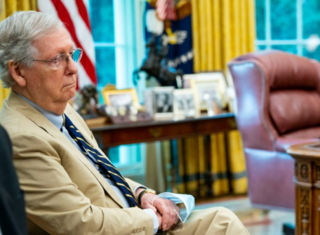 Senate Majority Leader Mitch McConnell (R-Ky.) listens as President Donald Trump talks to reporters in the Oval Office at the White House July 20, 2020 in Washington, D.C. (Photo: ScreenShot excerpt from photo by Doug Mills-Pool/Getty Images).