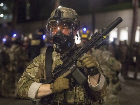 A federal agent in Portland, Oregon during a demonstration on the night of July 24, 2020. (Photo: Jake Borden)