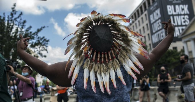 A Native American woman attends a protest at Black Lives Matter Plaza near the White House on July 4 in Washington, D.C. (Photo: Probal Rashid/LightRocket via Getty Images)