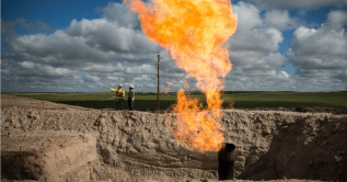 A gas flare is seen at an oil well site on July 26, 2013 outside Williston, North Dakota. (Photo: Andrew Burton/Getty Images)