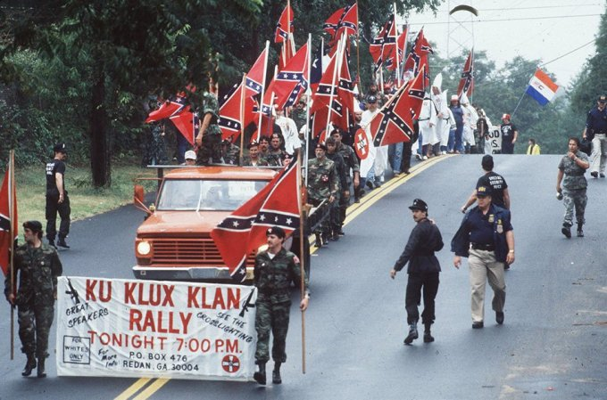 Stone Mountain Ku Klux Klan rally. Supporters of the Ku Klux Klan march May 4, 1989, Stone Mountain, Georgia (Paul Harris/Getty Images)