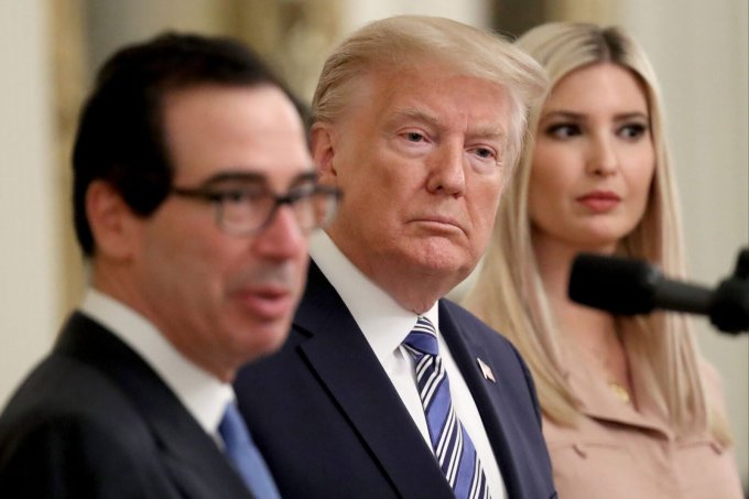 President Donald Trump and his daughter Ivanka Trump taking questions about the Paycheck Protection Program with Treasury Secretary Steven Mnuchin on April 28. (Win McNamee/Getty Images)