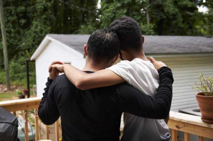 A father, left, and his son, who was detained in an American hotel and faced expulsion to Honduras. (Carolina Guerrero for ProPublica and The Texas Tribune)