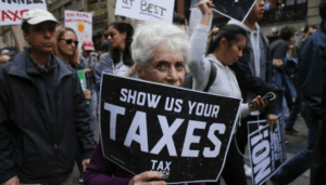 Protesters take part in the 'Tax March' calling on President Donald Trump to release his tax records in 2017 in New York. (Photo: Kena Betancur/AFP/Getty Images)