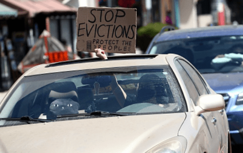Cars display signs requesting to stop evictions as protesters supporting the rent freeze gather in Chinatown on August 10, 2020 in Los Angeles, California. During the pandemic, California has passed a number of eviction protections that are under evaluation as they have started expiring. (Photo: Tommaso Boddi/Getty Images)