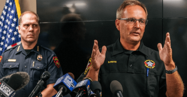 Kenosha Sheriff David Beth (r) speaks at a news conference on August 26, 2020 in Kenosha, Wisconsin. In addition to Beth, the ACLU is also calling for immediate resignation of Kenosha, Wisconsin chief of police Daniel Miskinis (l). (Screenshot from photo: Brandon Bell/Getty Images)
