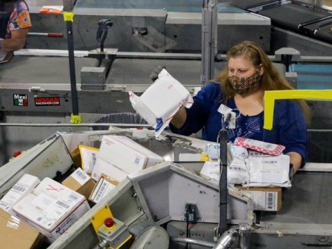 Mail clerks sort packages at a USPS Processing and Distribution Center on Thursday, May 14, 2020 in City of Industry, California. (Photo: Irfan Khan/Los Angeles Times via Getty Images)