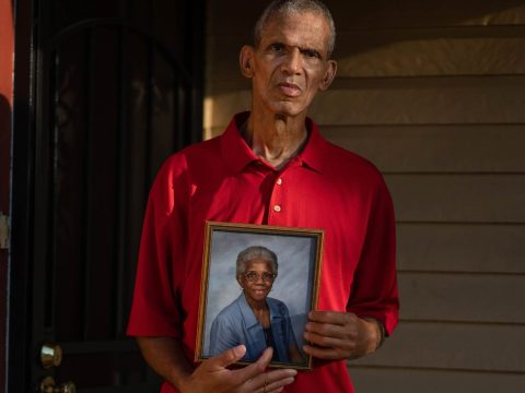 Rodney Lavalais holds a photo of his mother, Sarah Johnson, outside her New Orleans home. (Kathleen Flynn/ProPublica)