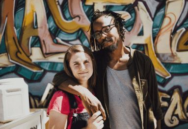 Derrick Sanderlin with his wife, Cayla Sanderlin. Derrick, who had trained San Jose police recruits on avoiding racial bias, was hit by a projectile that ruptured a testicle.(THE SANDERLIN FAMILY)