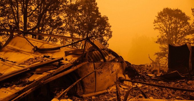 An orange smoke-filled sky and burnt remains are seen after the passage of the Santiam Fire in Gates, Oregon on September 10, 2020. (Photo: Kathryn Elsesser/AFP via Getty Images)