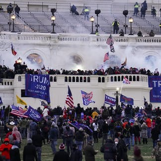 Rioters storm the U.S. Capitol on Jan. 6, 2021, seeking to intimidate politicians into overturning the presidential election