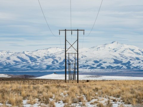 An existing transmission line passes through the heart of Thacker Pass, following the slope down into the Quinn River Valley below. The Santa Rosa Mountains rise up in the background. Russel Albert Daniels / High Country News