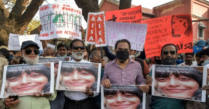 Activists belonging to various human rights organizations hold placards as they stage a demonstration against the arrest of the activist Disha Ravi by Delhi Police for her alleged involvement in the instigation of violence during the farmers' protest in Bangalore, India on February 15, 2021. (Photo: Manjunath Kiran/AFP via Getty Images)