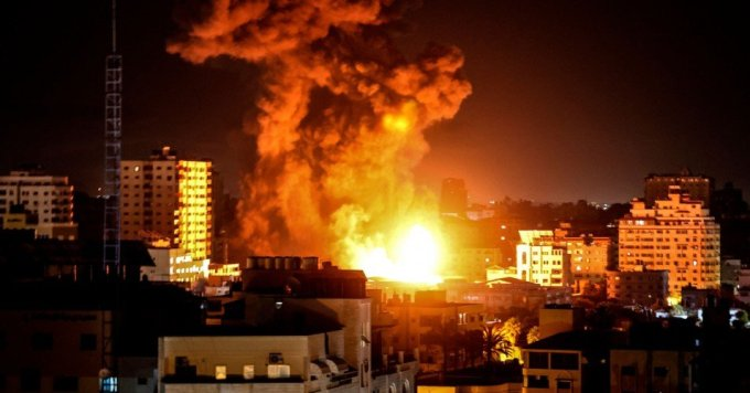 Fire and smoke rise above buildings in Gaza City as Israeli warplanes target the occupied Palestinian territory on May 17, 2021. (Photo: Mahmud Hams/AFP via Getty Images)