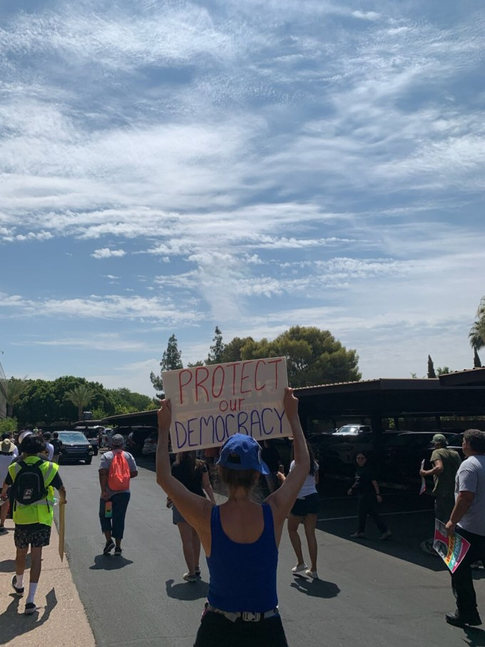 """Protesters gathered outside the Phoenix office of Sen. Kyrsten Sinema, D-Ariz., to urge her to vote for doing away with the filibuster - something Sinema has said she will not do. Critics say the filibuster will let Republicans torpedo President Biden's agenda. (Photo by <a href=""""https://cronkitenews.azpbs.org/people/harrison-klopp/"""" target=""""_blank"""" rel=""""noopener"""">Harrison Klopp</a>/Cronkite News)"""