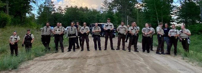 On July 23, 2021, a Minnesota court ordered Hubbard County police officers to stop obstructing a driveway that leads to a Line 3 pipeline protest camp. (Photo: Giniw Collective)