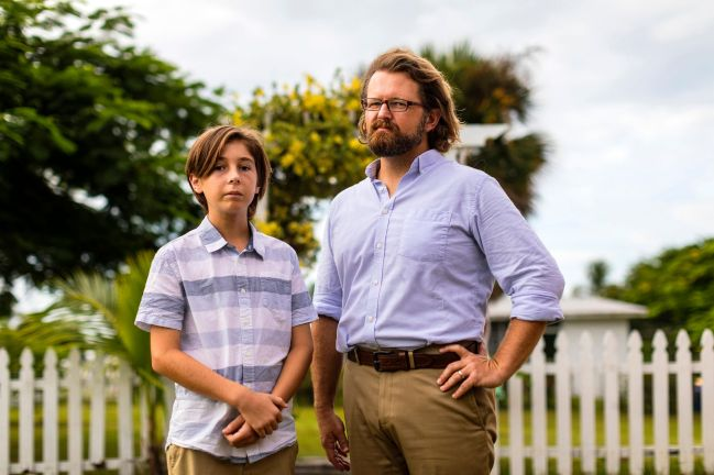 Seth Osborn with his father, Nathaniel Osborn, at their home in Jensen Beach, Florida. Credit: Saul Martinez for ProPublica