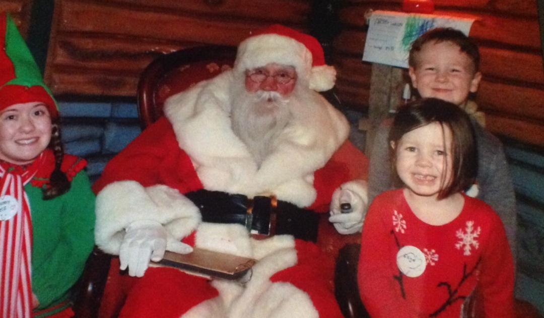 Boy child and girl child with Father Christmas