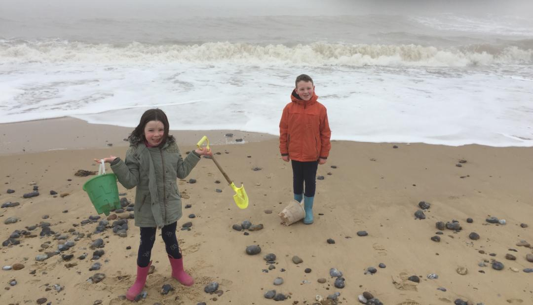 Children on holiday playing on the beach
