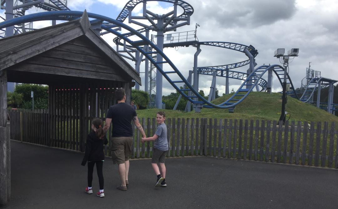 Family walking under the Cobra Ride at Paultons Park