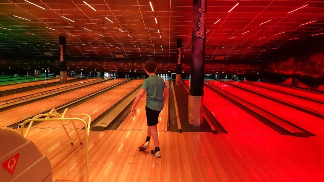 Boy Child Bowling at Rollerbowl