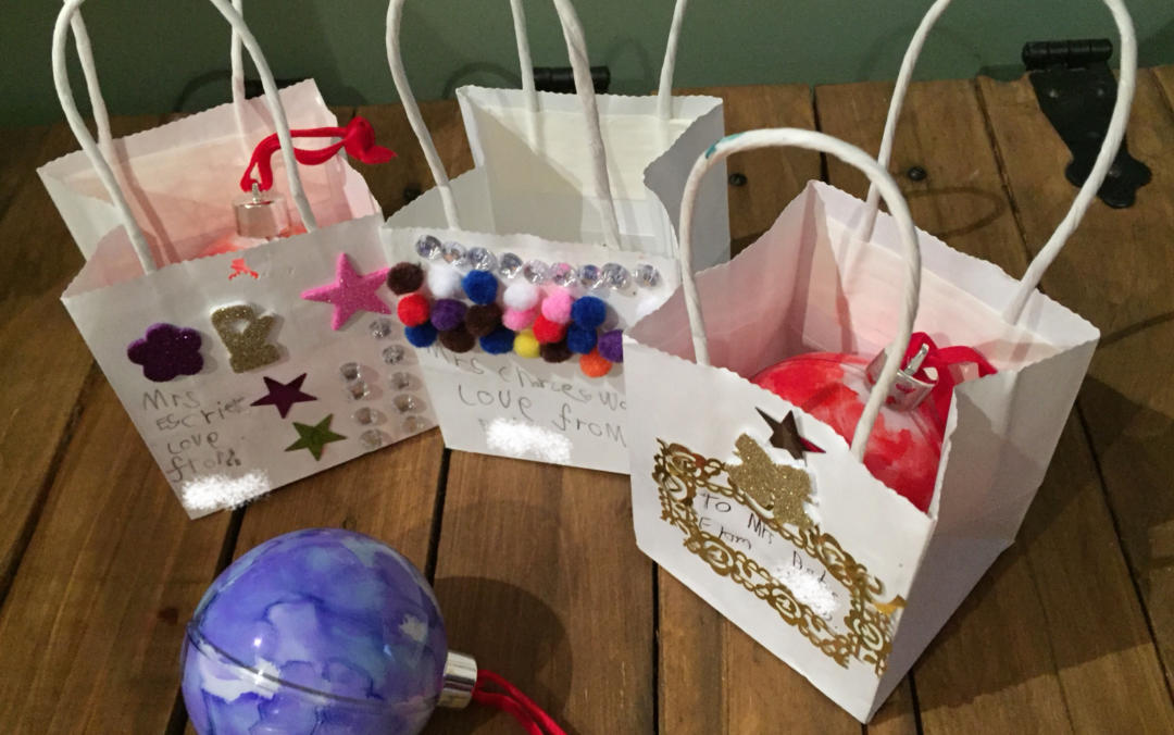 The baubles in hand decorated gift bags