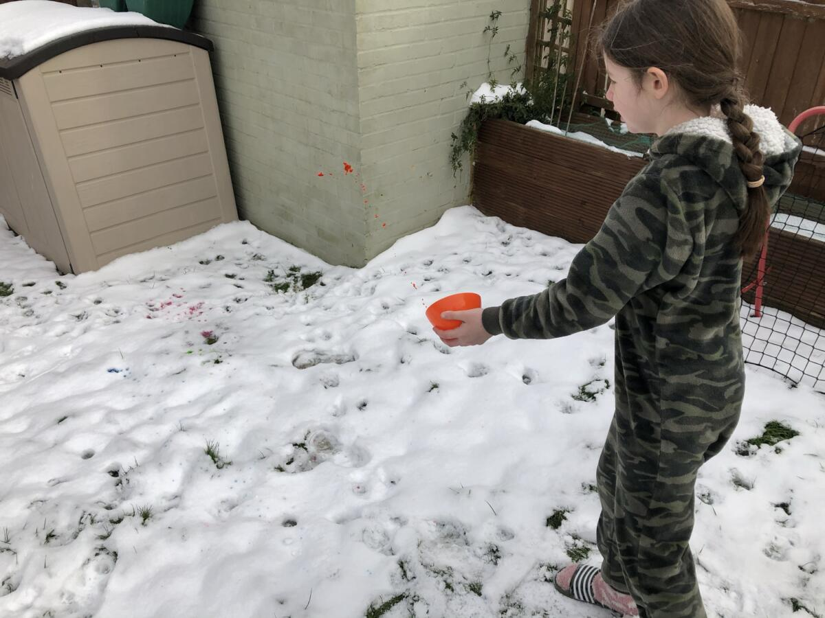 Throwing the rest of the coloured water in the snow
