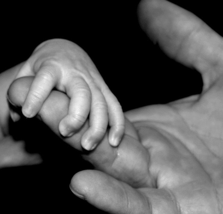 young hand holding