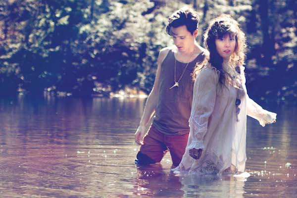 purity ring band in a lake