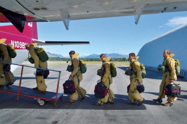 Eight veteran smokejumpers and two rookie trainees load into the twin-engine turboprop for practice jumps