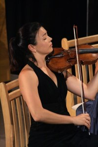 Violinist Serena McKinney delivered a poignant passage.