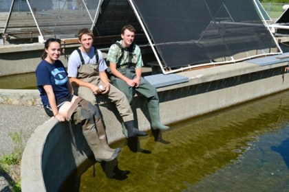 College interns Claire Bartholemew, Guy Thyer and Jamie Daudon prepare to check on captive beavers at the Winthrop National Fish Hatchery. Photo by Laurelle Walsh