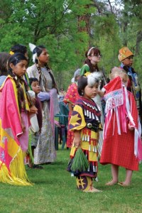 Dancers and powwow attendees stood at attention while the invocation was given on Saturday. Photo by Laurelle Walsh